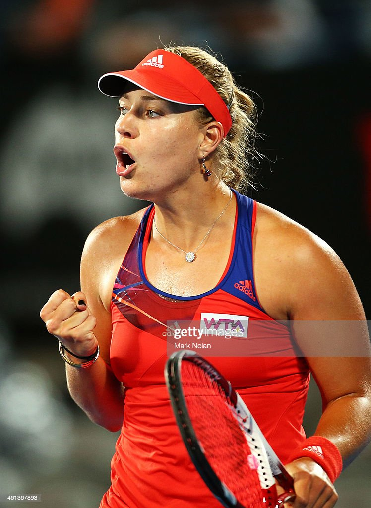 <a gi-track='captionPersonalityLinkClicked' href=/galleries/search?phrase=Angelique+Kerber&family=editorial&specificpeople=4307332 ng-click='$event.stopPropagation()'>Angelique Kerber</a> of Germany celebrates winning a point in her match against Carla Suarez Navarro of Spain during day four of the 2014 Sydney International at Sydney Olympic Park Tennis Centre on January 8, 2014 in Sydney, Australia.