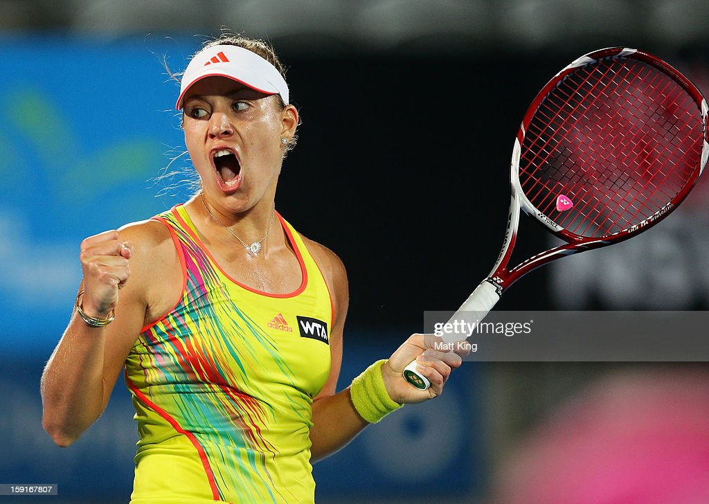 <a gi-track='captionPersonalityLinkClicked' href=/galleries/search?phrase=Angelique+Kerber&family=editorial&specificpeople=4307332 ng-click='$event.stopPropagation()'>Angelique Kerber</a> of Germany celebrates winning a point in her quarter final match against Svetlana Kuznetsova of Russia during day four of the Sydney International at Sydney Olympic Park Tennis Centre on January 9, 2013 in Sydney, Australia.
