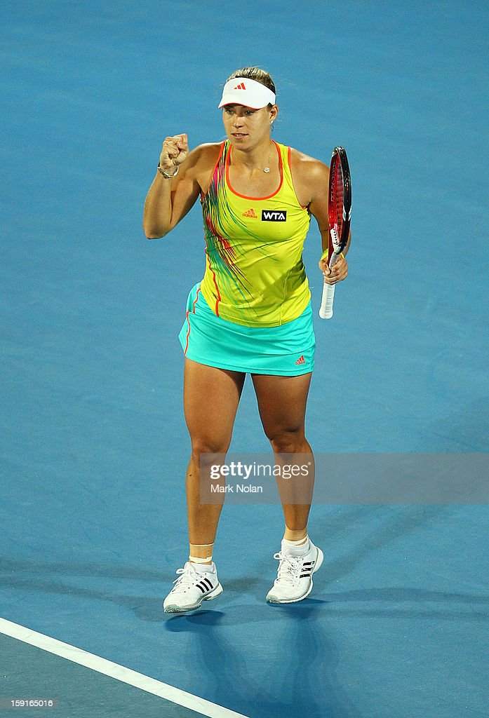 Angelique Kerber of Germany celebrates winning her her quarter final match against Svetlana Kuznetsova of Russia during day four of the Sydney International at Sydney Olympic Park Tennis Centre on January 9, 2013 in Sydney, Australia.