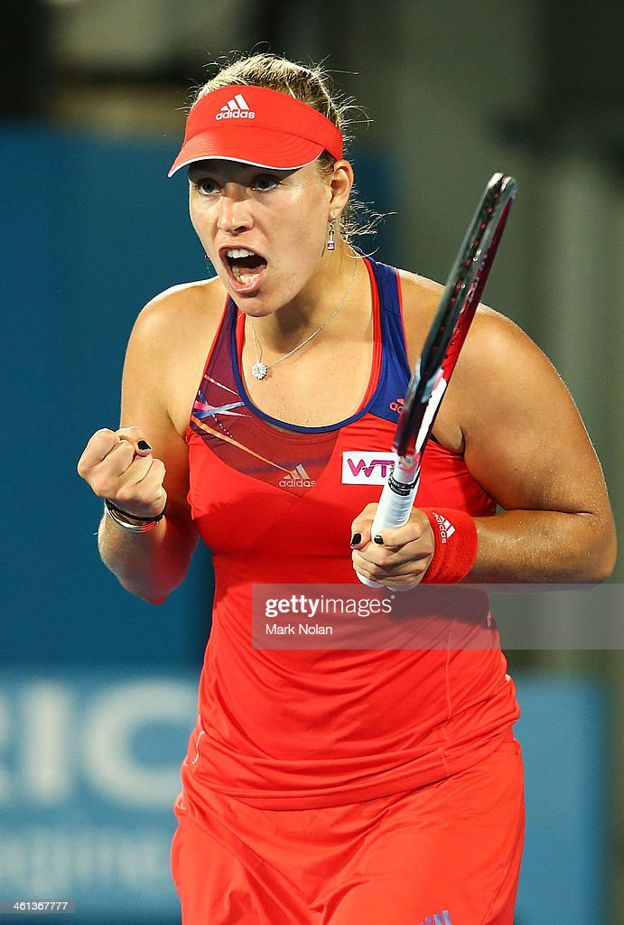 Angelique Kerber of Germany celebrates winning her match against Carla Suarez Navarro of Spain during day four of the 2014 Sydney International at Sydney Olympic Park Tennis Centre on January 8, 2014 in Sydney, Australia.