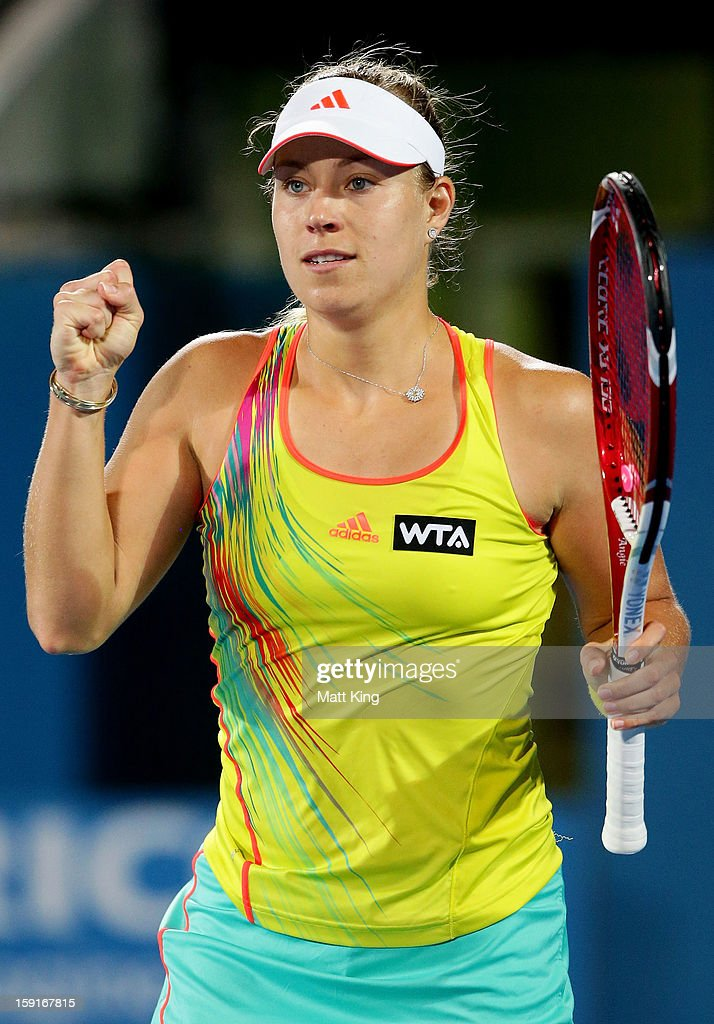 Angelique Kerber of Germany celebrates winning match point in her quarter final match against Svetlana Kuznetsova of Russia during day four of the Sydney International at Sydney Olympic Park Tennis Centre on January 9, 2013 in Sydney, Australia.