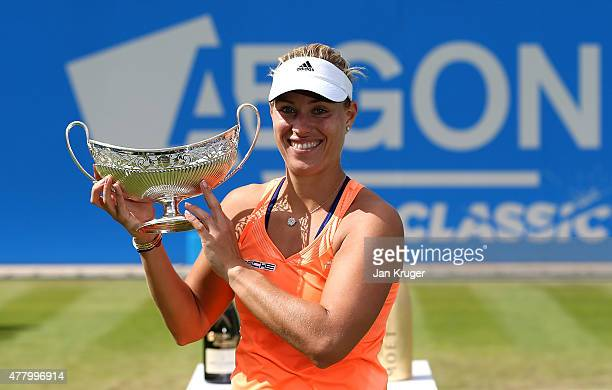 Angelique Kerber of Germany celebrates with the tyrophy after victory in her singles final match against Karolina Pliskova of Czech Republic on day...