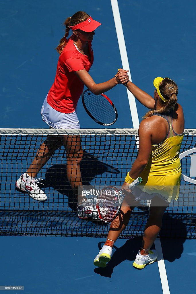 Angelique Kerber of Germany (R) congratulates Ekaterina Makarova of Russia after winning her fourth round match during day seven of the 2013 Australian Open at Melbourne Park on January 20, 2013 in Melbourne, Australia.