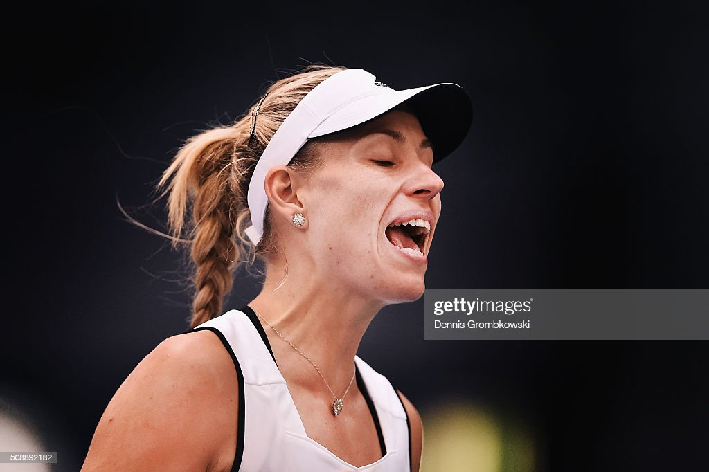 <a gi-track='captionPersonalityLinkClicked' href=/galleries/search?phrase=Angelique+Kerber&family=editorial&specificpeople=4307332 ng-click='$event.stopPropagation()'>Angelique Kerber</a> of Germany despairs during her match against Belinda Bencic of Switzerland on Day 2 of the 2016 FedCup World Group Round 1 match between Germany and Switzerland at Messe Leipzig on February 7, 2016 in Leipzig, Germany.