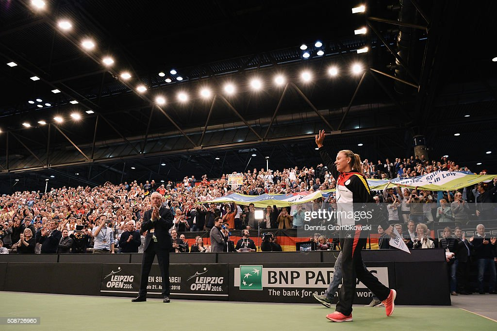 <a gi-track='captionPersonalityLinkClicked' href=/galleries/search?phrase=Angelique+Kerber&family=editorial&specificpeople=4307332 ng-click='$event.stopPropagation()'>Angelique Kerber</a> of Germany enters the court for the official opening ceremony during Day 1 of the 2016 Fed Cup World Group First Round match between Germany and Switzerland at Messe Leipzig on February 6, 2016 in Leipzig, Germany.