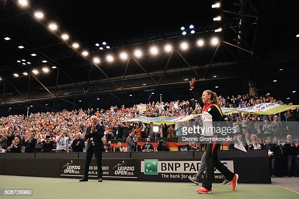 Angelique Kerber of Germany enters the court for the official opening ceremony during Day 1 of the 2016 Fed Cup World Group First Round match between...