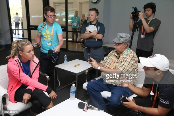 Angelique Kerber of Germany fields questions from the media at a player availability session during the Miami Open at the Crandon Park Tennis Center...