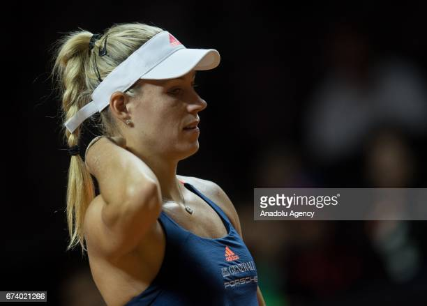 Angelique Kerber of Germany gestures as she compete against Kristina Mladenovic of France during the Porsche Tennis Grand Prix at Porsche Arena in...