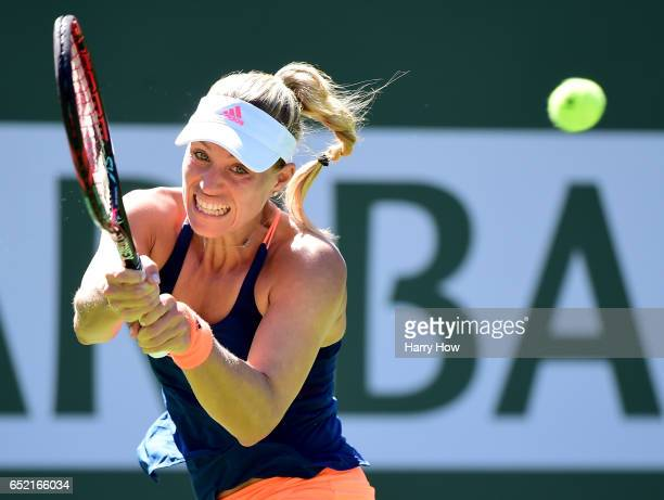 Angelique Kerber of Germany hits a backhand during her straight set win over Andrea Petkovic of Germany at Indian Wells Tennis Garden on March 11...