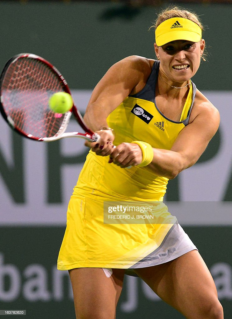 Angelique Kerber of Germany hits a backhand return against Caroline Wozniacki of Denmark on March 15, 2013 in Indian Wells, California, during their semirfinal match at the BNP Paribas Open. AFP PHOTO/Frederic J. BROWN