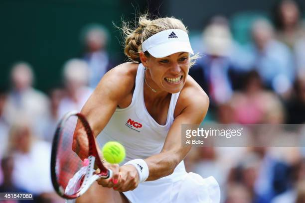Angelique Kerber of Germany hits a backhand return during her Ladies' Singles fourth round match against Maria Sharapova of Russia on day eight of...