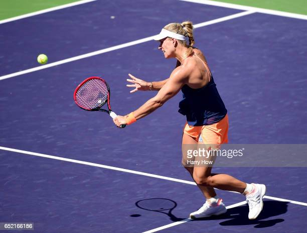 Angelique Kerber of Germany hits a backhand volley during her straight set win over Andrea Petkovic of Germany at Indian Wells Tennis Garden on March...