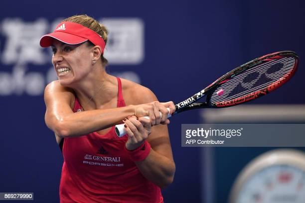 Angelique Kerber of Germany hits a return against Ashleigh Barty of Australia during their women's singles match at the Zhuhai Elite Trophy tennis...