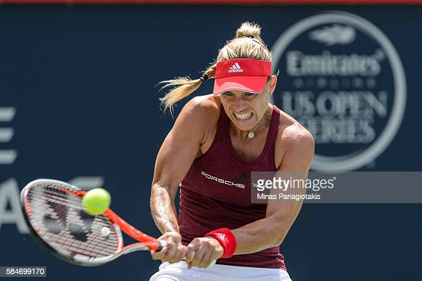 Angelique Kerber of Germany hits a return against Simona Halep of Romania during day six in semifinal round action of the Rogers Cup at Uniprix...