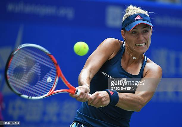 Angelique Kerber of Germany hits a return during her second round match against Kristina Mladenovic of France at the WTA Wuhan Open in Wuhan in...