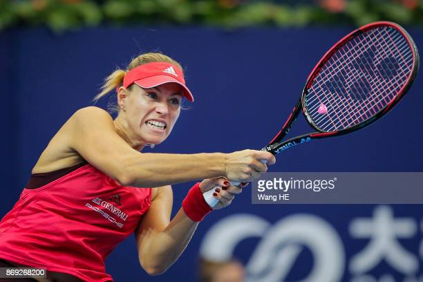 Angelique Kerber of Germany hits a return in her first round match against Ashlei Barty of Australia during the WTA Elite Trophy Zhuhai 2017 at...