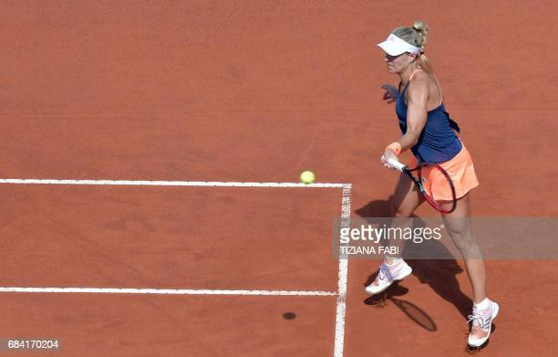 Angelique Kerber of Germany hits a return to Estonia's Anett Kontaveit during their match at the WTA Tennis Open tournament at the Foro Italico on...