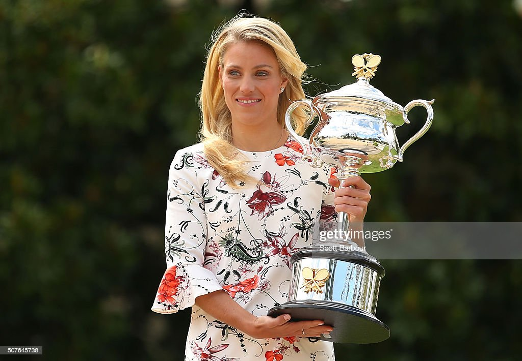 <a gi-track='captionPersonalityLinkClicked' href=/galleries/search?phrase=Angelique+Kerber&family=editorial&specificpeople=4307332 ng-click='$event.stopPropagation()'>Angelique Kerber</a> of Germany holds the Daphne Akhurst Memorial Cup during a photocall at Government House after winning the 2016 Australian Open on January 31, 2016 in Melbourne, Australia.