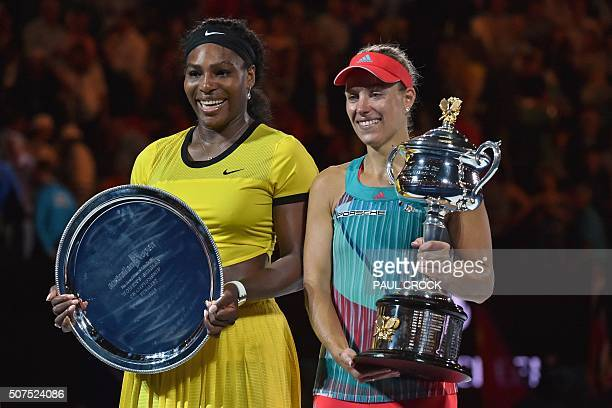 Angelique Kerber of Germany holds the winner's trophy during the awards ceremony following her victory over Serena Williams of the US in their...