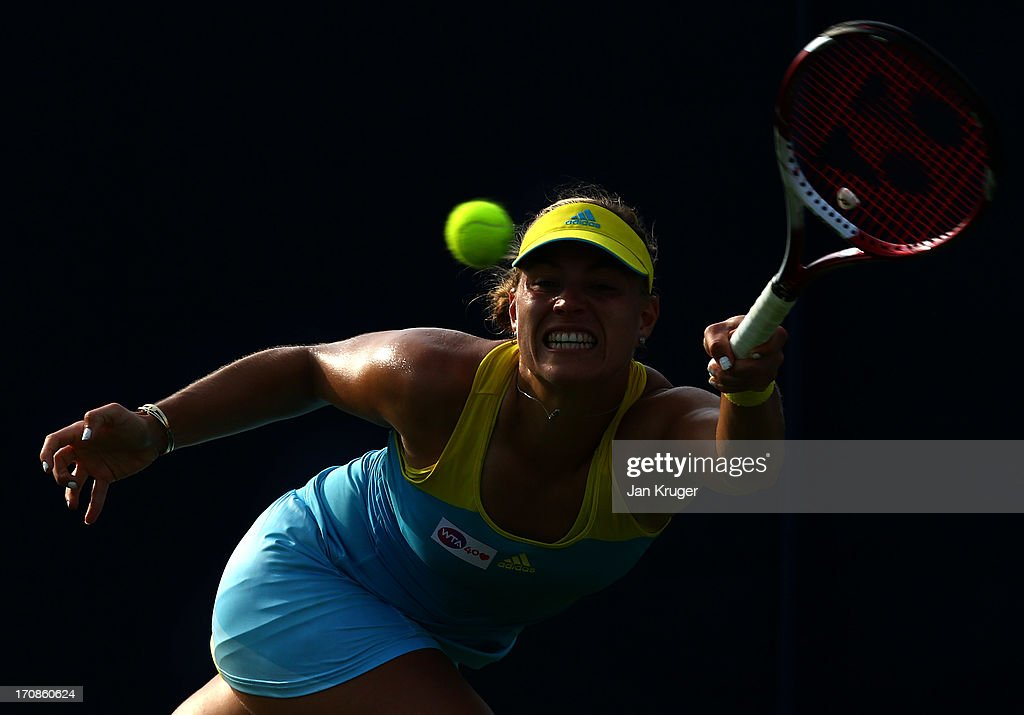 <a gi-track='captionPersonalityLinkClicked' href=/galleries/search?phrase=Angelique+Kerber&family=editorial&specificpeople=4307332 ng-click='$event.stopPropagation()'>Angelique Kerber</a> of Germany in action against Ekaterina Makarova of Russia during day five of the AEGON International tennis tournament at Devonshire Park on June 19, 2013 in Eastbourne, England.