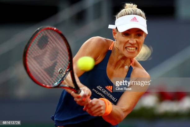 Angelique Kerber of Germany in action during her match against Eugenie Bouchard of Canada on day five of the Mutua Madrid Open tennis at La Caja...