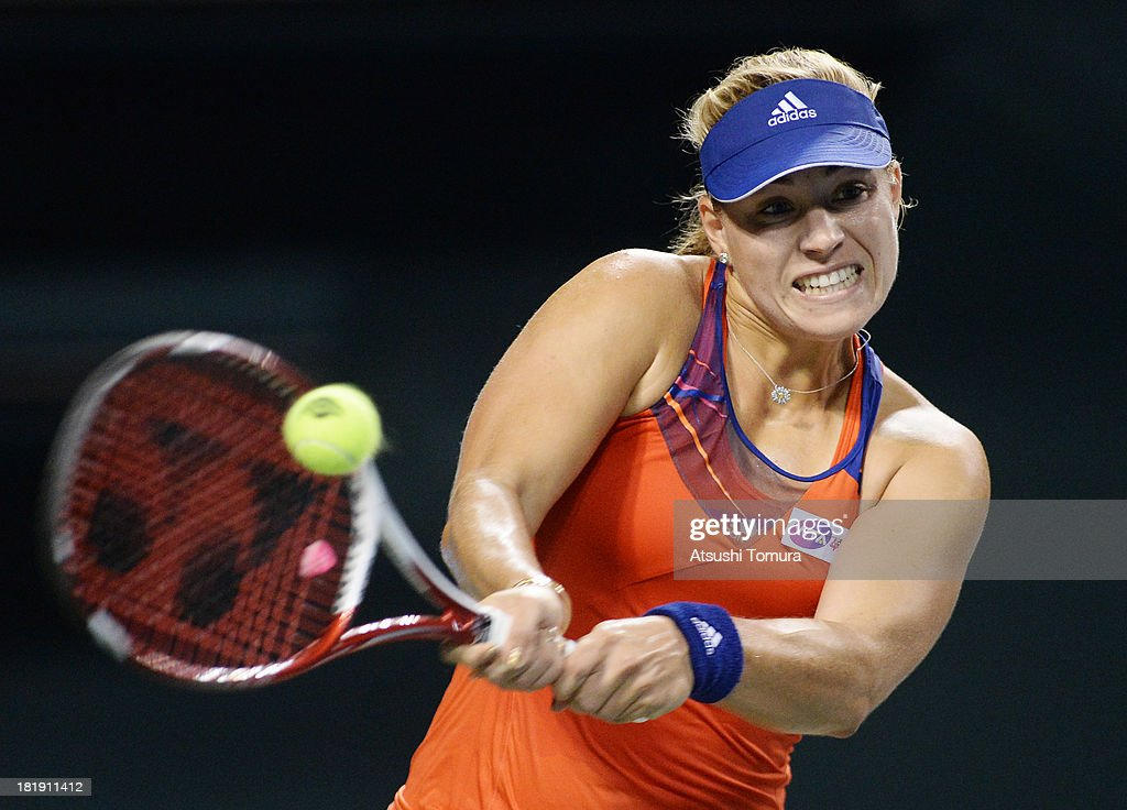<a gi-track='captionPersonalityLinkClicked' href=/galleries/search?phrase=Angelique+Kerber&family=editorial&specificpeople=4307332 ng-click='$event.stopPropagation()'>Angelique Kerber</a> of Germany in action during her women's singles quarter final match against Agnieszka Radwanska of Poland during day five of the Toray Pan Pacific Open at Ariake Colosseum on September 26, 2013 in Tokyo, Japan.