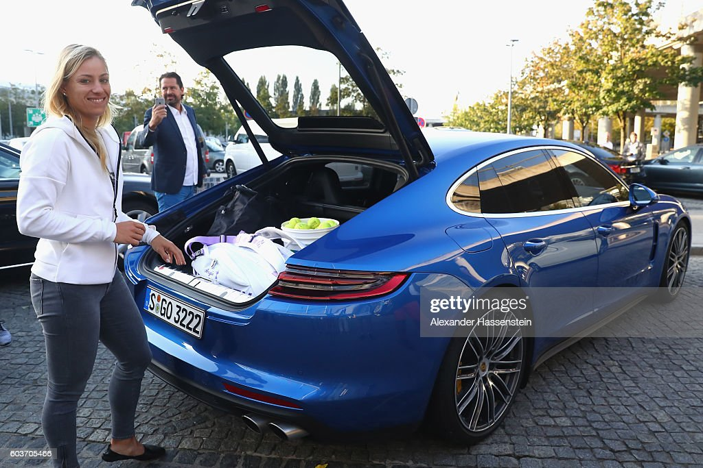 Angelique Kerber of Germany in front of the a new Porsche Panamera Turbo after returning as new Tennis World number One and winner of the US Open at Munich Airport on September 13, 2016 in Munich, Germany.