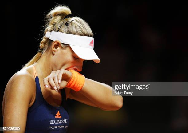 Angelique Kerber of Germany is dejected after losing a point during her match against Kristina Mladenovic of France during the Porsche Tennis Grand...