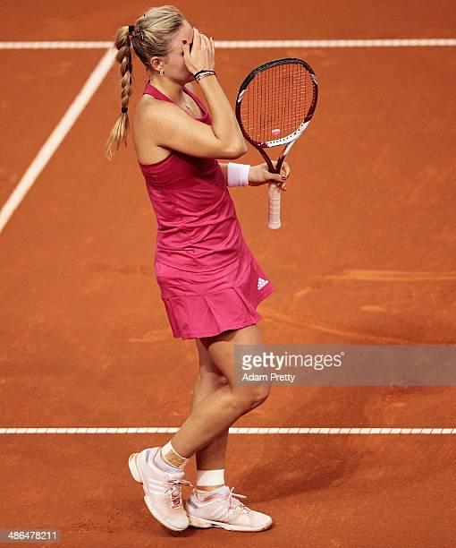 Angelique Kerber of Germany is dejected during her match against Carla Suarez Navarro of Spain on day four of the Porsche Tennis Grand Prix 2014 at...