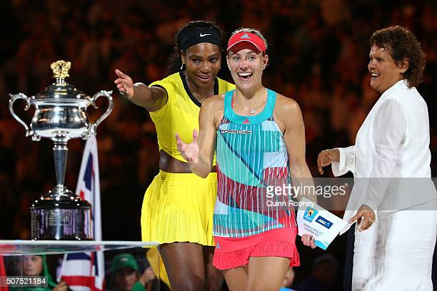 Angelique Kerber of Germany is presented with the Daphne Akhurst Trophy after winning the Women's Singles Final against Serena Williams of the United...