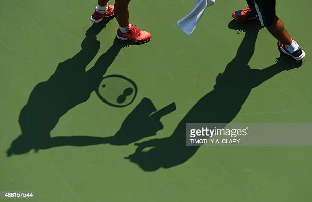 Angelique Kerber of Germany is seen in shadow during play against Alexandra Dulgheru of Romania during their 2015 US Open Women's singles round 1...