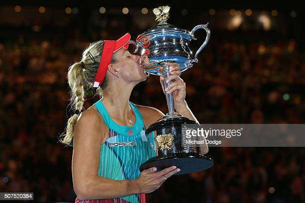 Angelique Kerber of Germany kisses the Daphne Akhurst Trophy after winning the Women's Singles Final against Serena Williams of the United States...
