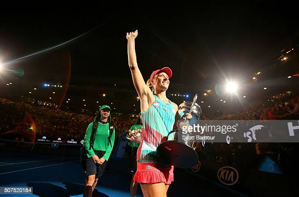 Angelique Kerber of Germany leaves Rod Laver Arena with the Daphne Akhurst Trophy after winning the Women's Singles Final against Serena Williams of...