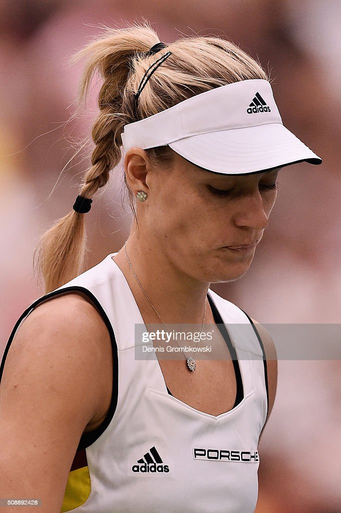 <a gi-track='captionPersonalityLinkClicked' href=/galleries/search?phrase=Angelique+Kerber&family=editorial&specificpeople=4307332 ng-click='$event.stopPropagation()'>Angelique Kerber</a> of Germany looks dejected during her match against Belinda Bencic of Switzerland on Day 2 of the 2016 FedCup World Group Round 1 match between Germany and Switzerland at Messe Leipzig on February 7, 2016 in Leipzig, Germany.
