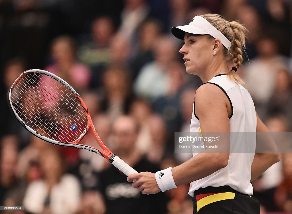 <a gi-track='captionPersonalityLinkClicked' href=/galleries/search?phrase=Angelique+Kerber&family=editorial&specificpeople=4307332 ng-click='$event.stopPropagation()'>Angelique Kerber</a> of Germany looks on during her match against Belinda Bencic of Switzerland on Day 2 of the 2016 FedCup World Group Round 1 match between Germany and Switzerland at Messe Leipzig on February 7, 2016 in Leipzig, Germany.