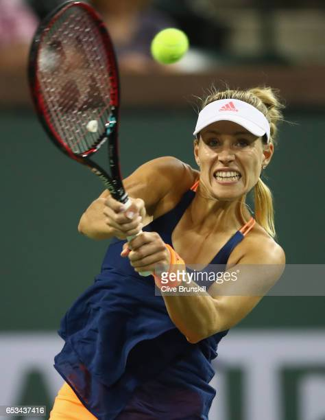 Angelique Kerber of Germany plays a backhand against Elena Vesnina of Russia in their fourth round match during day nine of the BNP Paribas Open at...