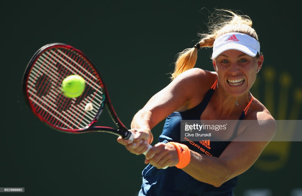 Angelique Kerber of Germany plays a backhand against Pauline Parmentier of France in their third round match during day eight of the BNP Paribas Open at Indian Wells Tennis Garden on March 13, 2017 in Indian Wells, California.