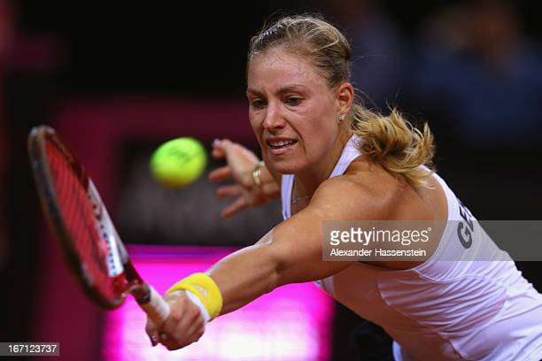 Angelique Kerber of Germany plays a backhand during her match against Ana Ivanovic of Serbia at the Fed Cup World Group Play off between Germany and...