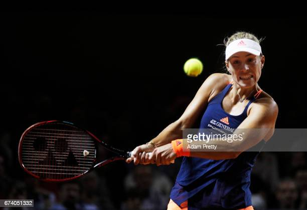 Angelique Kerber of Germany plays a backhand during her match against Kristina Mladenovic of France during the Porsche Tennis Grand Prix at Porsche...