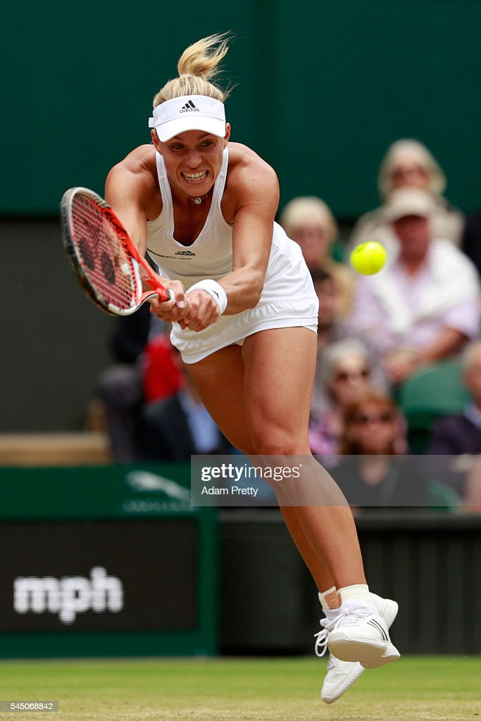 Angelique Kerber of Germany plays a backhand during the Ladies Singles Quarter Finals match against Simona Halep of Romania on day eight of the...