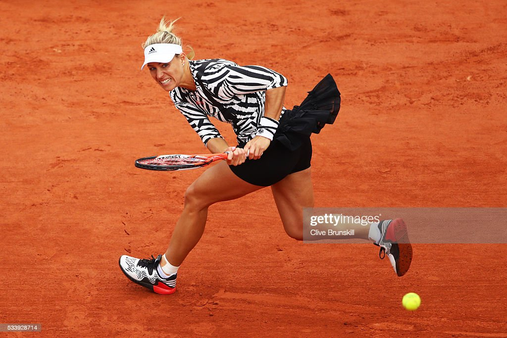 <a gi-track='captionPersonalityLinkClicked' href=/galleries/search?phrase=Angelique+Kerber&family=editorial&specificpeople=4307332 ng-click='$event.stopPropagation()'>Angelique Kerber</a> of Germany plays a backhand during the Women's Singles first round match against Kiki Bertens of the Netherlands on day three of the 2016 French Open at Roland Garros on May 24, 2016 in Paris, France.