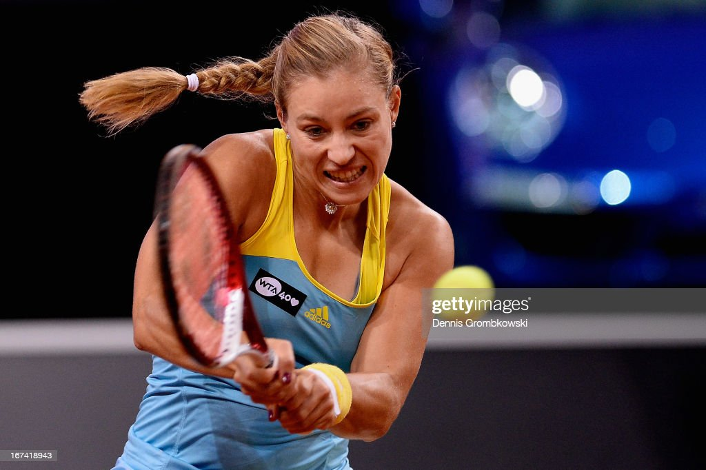 Angelique Kerber of Germany plays a backhand in her match against Anastasia Pavlyuchenkova of Russia during Day 4 of the Porsche Tennis Grand Prix at Porsche-Arena on April 25, 2013 in Stuttgart, Germany.