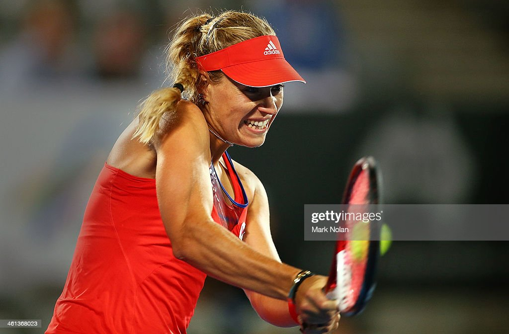 Angelique Kerber of Germany plays a backhand in her match against Carla Suarez Navarro of Spain during day four of the 2014 Sydney International at Sydney Olympic Park Tennis Centre on January 8, 2014 in Sydney, Australia.