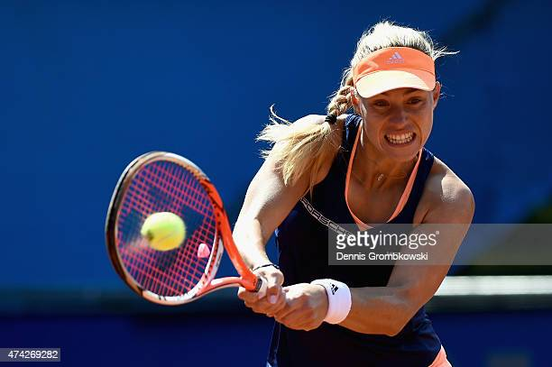 Angelique Kerber of Germany plays a backhand in her match against Misaki Doi of Japan during Day six of the Nuernberger Versicherungscup 2015 on May...