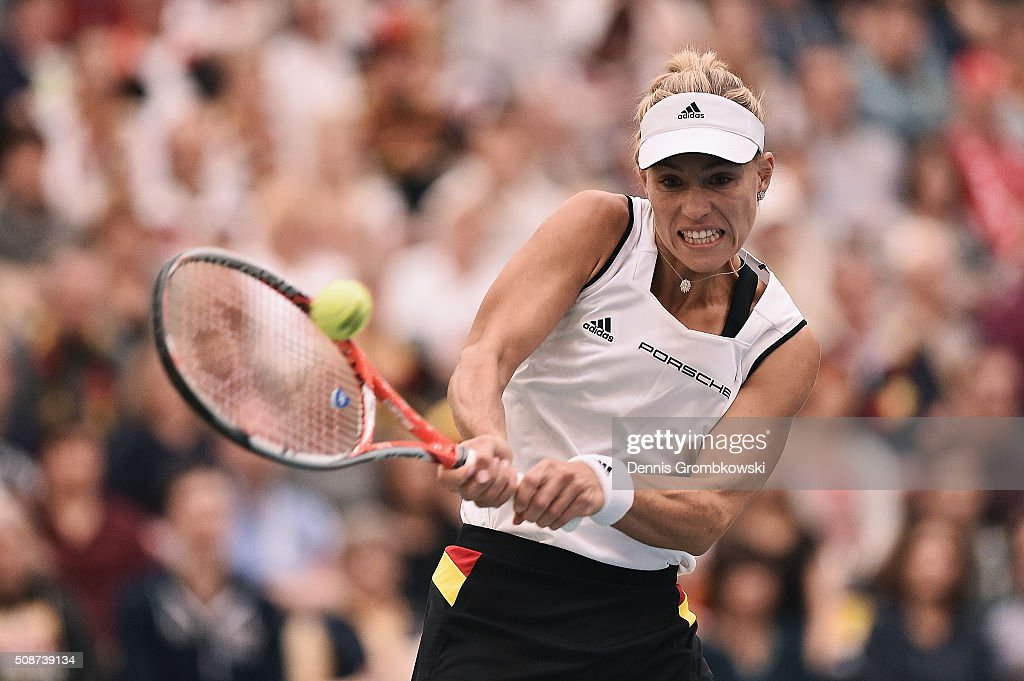 Angelique Kerber of Germany plays a backhand in her match against Timea Bacsinszky of Switzerland during Day 1 of the 2016 Fed Cup World Group First Round match between Germany and Switzerland at Messe Leipzig on February 6, 2016 in Leipzig, Germany.