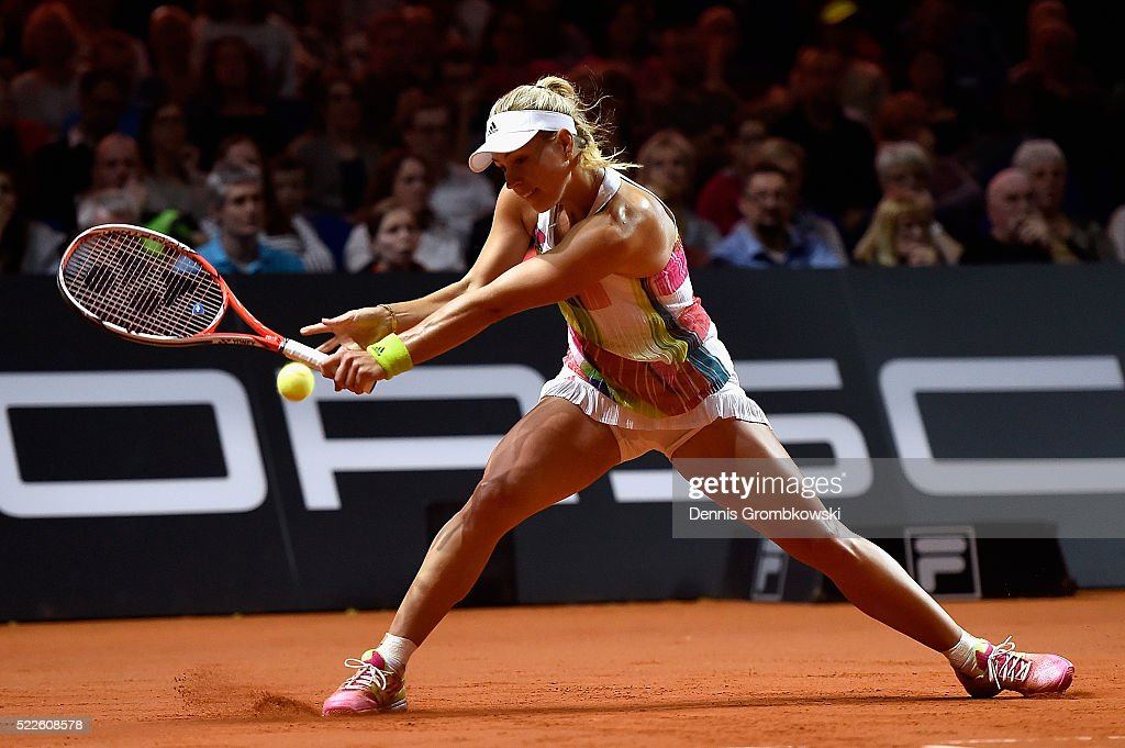 Angelique Kerber of Germany plays a backhand in her match against Annika Beck of Germany during Day 3 of the Porsche Tennis Grand Prix at Porsche-Arena on April 20, 2016 in Stuttgart, Germany.