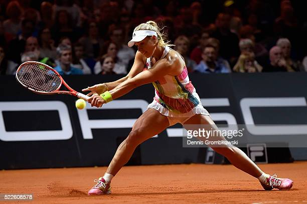Angelique Kerber of Germany plays a backhand in her match against Annika Beck of Germany during Day 3 of the Porsche Tennis Grand Prix at...