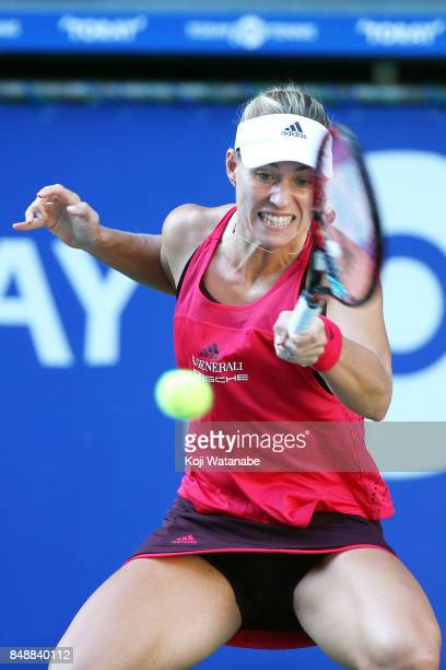 Angelique Kerber of Germany plays a backhand in her match against Naomi Osaka of Japan during women's singles match day one of the Toray Pan Pacific...