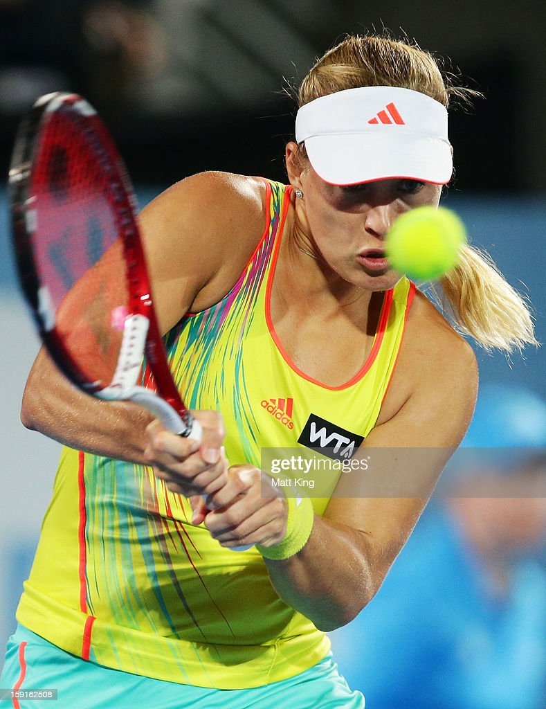 Angelique Kerber of Germany plays a backhand in her quarter final match against Svetlana Kuznetsova of Russia during day four of the Sydney International at Sydney Olympic Park Tennis Centre on January 9, 2013 in Sydney, Australia.