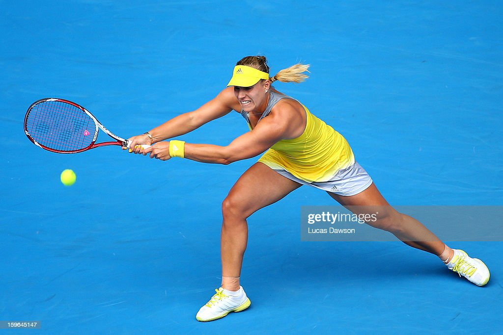 Angelique Kerber of Germany plays a backhand in her third round match against Madison Keys of the United States of America during day five of the 2013 Australian Open at Melbourne Park on January 18, 2013 in Melbourne, Australia.
